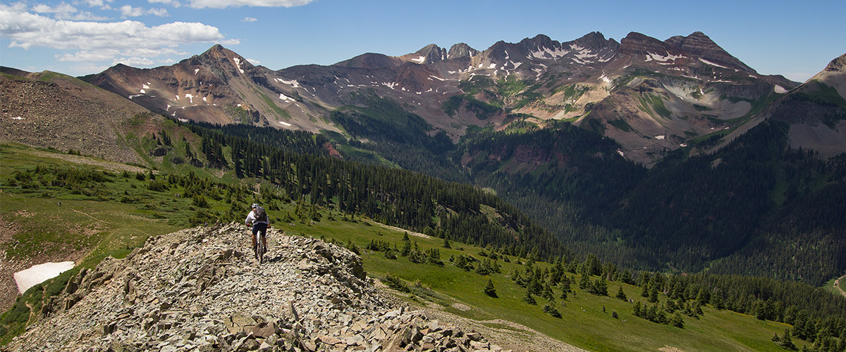 Mountain biker high on a ridge.