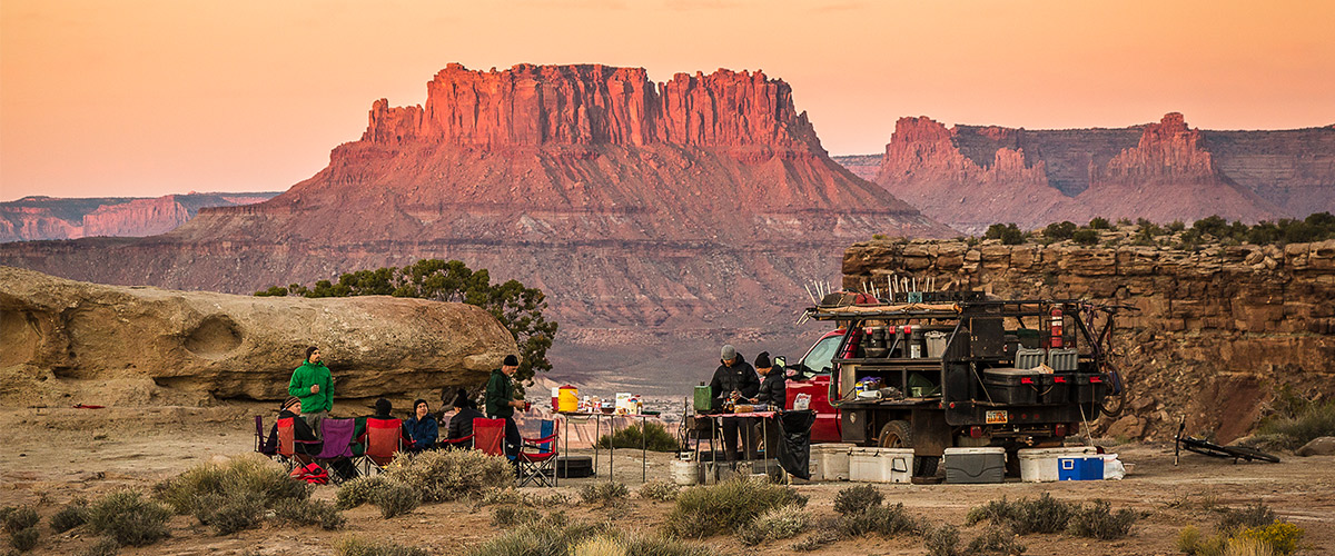 A Western Spirit style camp with dinner on the table