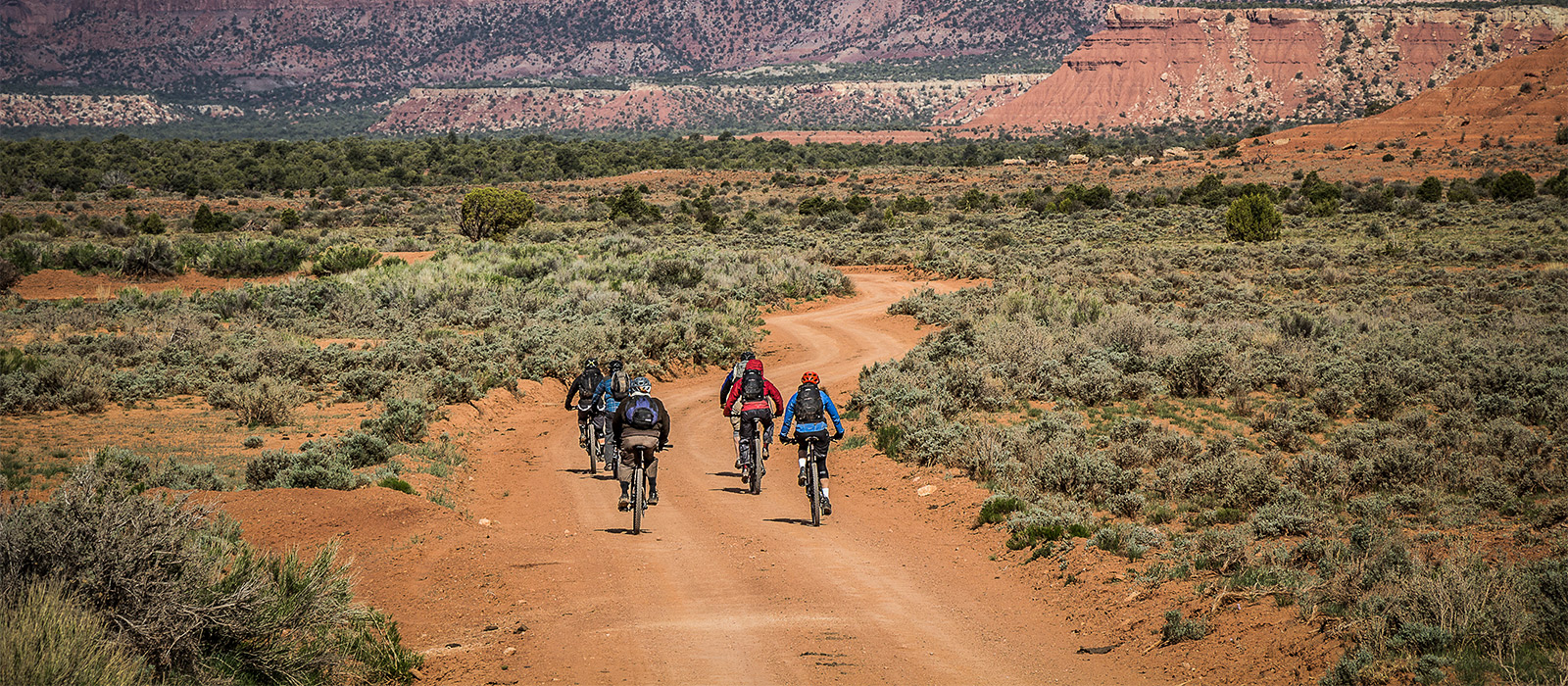 Riders traveling through a beautiful desert.